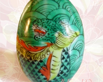 Vintage decorative egg with Chinese dragons, handpainted china dating to the 1980s