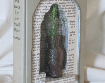 altered book sculpture with vase