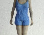 Sculpture Delphín. Girl swimmer.