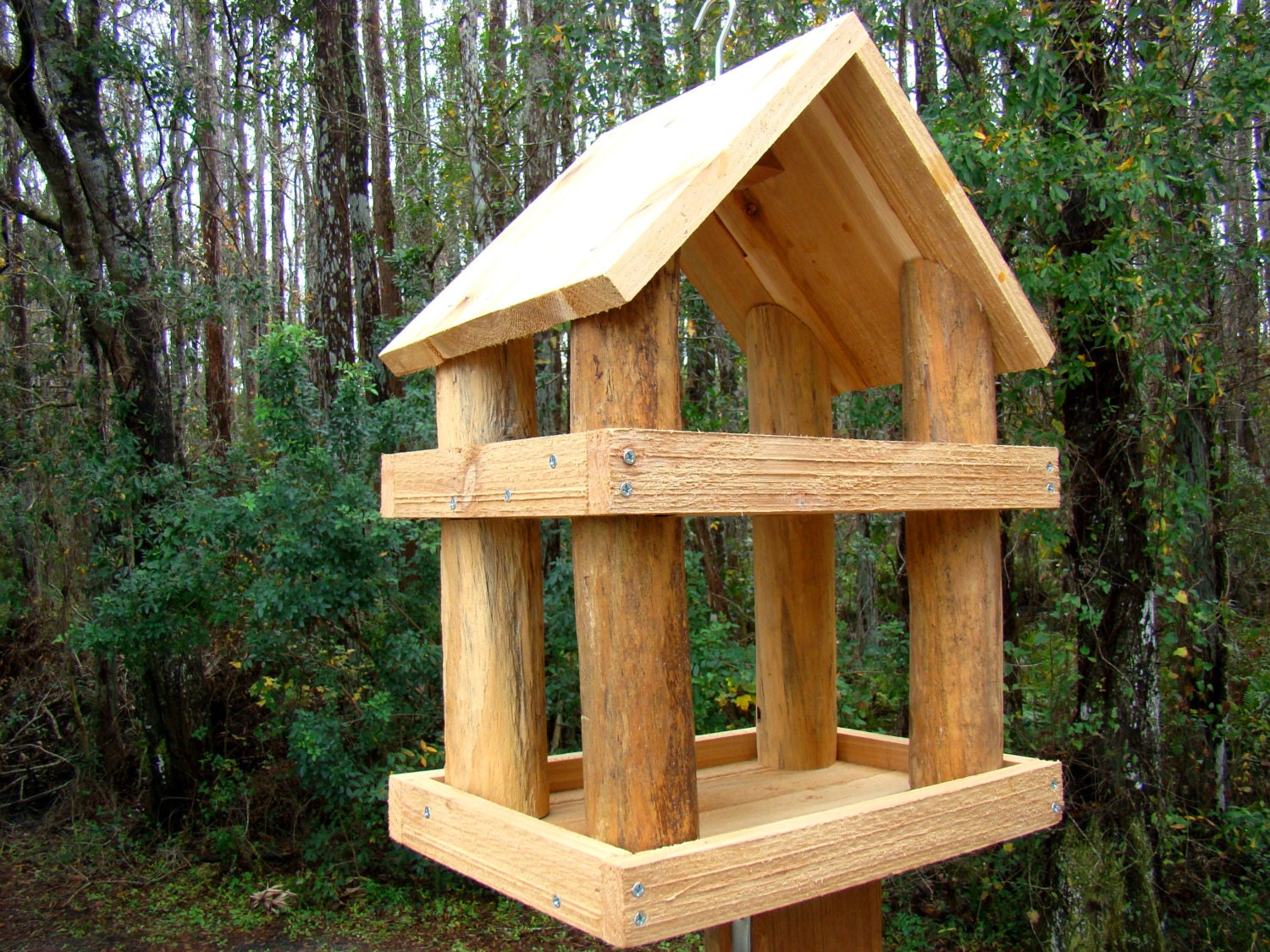 Large rustic wood platform bird feeder has levels use as a