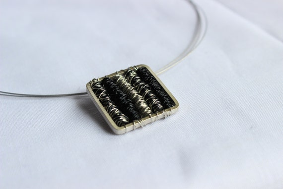 Tangle pendant square made of Sterling silver and Black copper wire