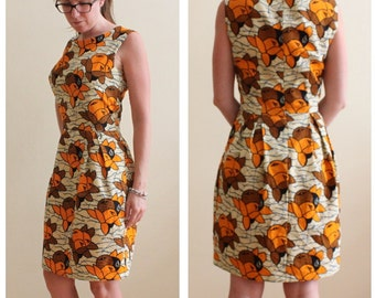 Handmade Summer Oranges fitted 1950's Dress. Fully lined, size UK12. Bust 36in Waist 28in