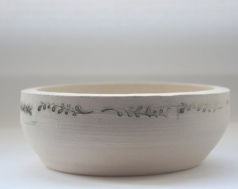 Stoneware vessel handthrown with embossed branches in ivory color