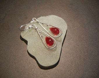 Silver wire wrapped earrings with Red Czech glass beads.