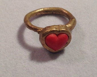 Bronze and red heart ring