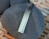 custom brass hand stamped one word bar necklace
