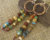 Multi Colored Beads Dangling from Copper Hoops