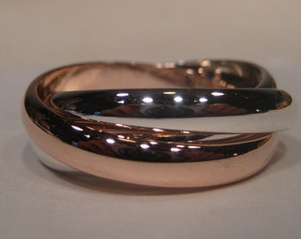 Built Guy Tough... Heavy Duty ... Guy Stuff ...Rolling   Ring ...  Sterling Silver and 14 kt ROSE Gold...
