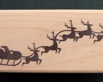 Santa Claus with sled rubber stamp P22
