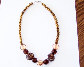 Necklace in brown and Gold beads.