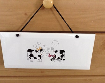Cartoon Cow Ceramic Plaque  it is 4 1/4 by 10