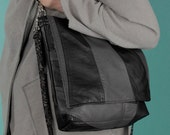 Grey and black recycled leather two strap flap bag