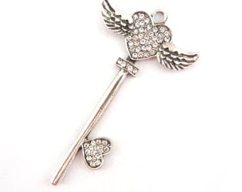 Silver-tone Skeleton Key Pendant with Winged Heart