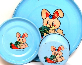 Lil Bunny Tin Toy Tea Setting, 3 piece set. Pink bunny on blue background.