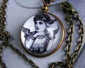 High domed magnified vintage brass pendant  - Angel and Bird - Free shipping