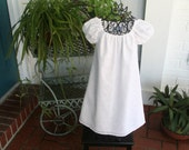 Flower girl white dress in a beautiful fabric   Available in sizes 1 thru 10