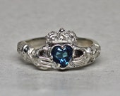 Medieval  claddaugh ring set with a blue topaz