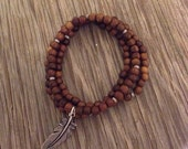 Set of 3 Handmade stacking bracelets boho jewelry bayong wood beads- 1 with silver plated feather charm