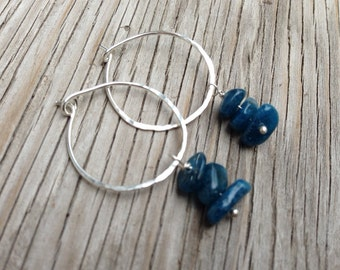 Earrings: Hammered  sterling silver hoops with blue apatite nugget drops
