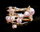 Whimsical hammered wrap ring with pink freshwater pearls