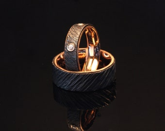 Iron and red gold wedding rings