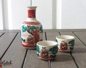 Vintage Sake Set, Kutani Japanese Porcelain, Red, Gold, Figures, Trees Ceramic Vessel