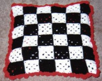 Black, red and white, checkered quillo/-like afghan pattern ©