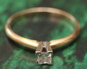 Diamond engagement ring princess 14k yellow gold. Size 7 .