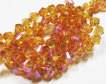 LOOSE Glass Beads - Glass Crystal Beads - 7mm Faceted Twist - Marigold Yellow with Pink AB (6 beads) - gla581