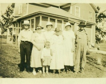 Farm Family Photo Man in Coveralls Women in Best Hats Standing in Front of House 1920s Black and White Vintage Photo Photograph