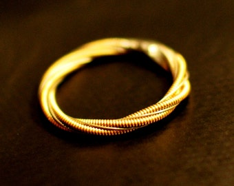 guitar string engagement or purity ring may by dremeworks on etsy. Black Bedroom Furniture Sets. Home Design Ideas