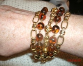 R J GRAZIANI 5 Strand Beaded Goldtone and Root Beer Colored Bead Bracelet