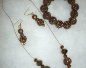 Rich Copper Faceted Beads with Iridescent Studded Copper Beads Neckace in Goldtone Necklace