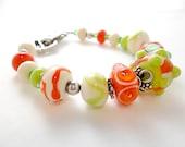 Lampworked Bracelet/ Beaded Bracelet/Orange, Ivory and Green Bracelet