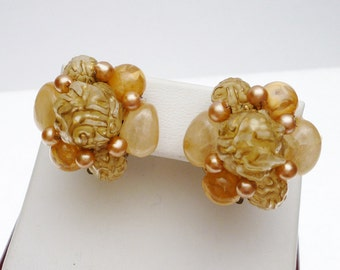 Carved Bead Tan And Camel Colored Gold Tone Clip On Earring