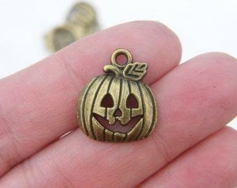 8 Halloween pumpkin charms antique bronze tone BC92