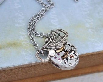 TINY TIME TRAVELER antiqued silver steampunk watch movement necklace with tiny leaf