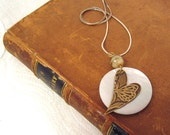 fall fashion trends -- Simple hand-embossed heart with shell focal pendant necklace