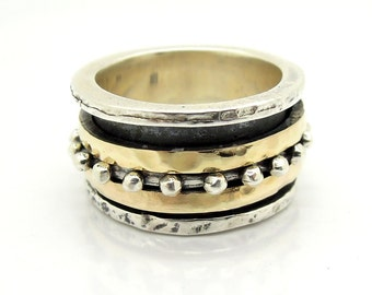 Wedding spinner band with silver & gold