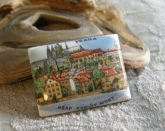 Vintage souvenir from Prague depicting the Prague Castle and the Charles Bridge