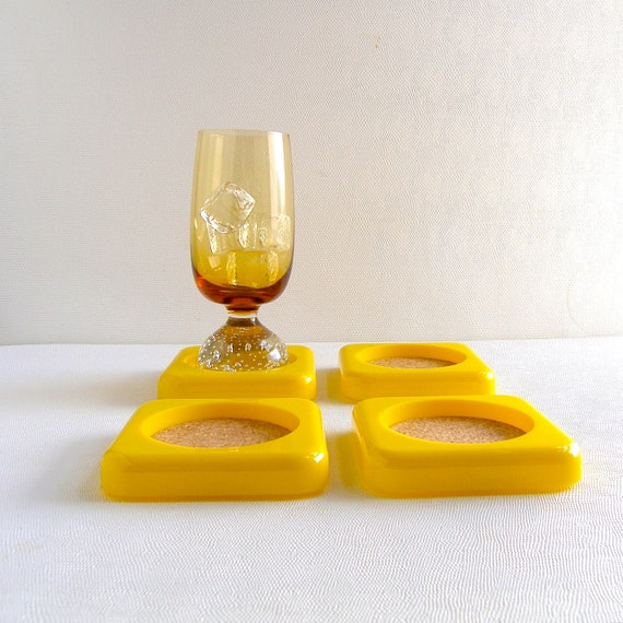 Mid century modern design mod yellow coaster set - rain coat yellow w/ cork - 1970s Palm Springs Jonathan Adler chic - Mad Men Mod bar needs