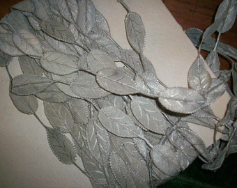 1 foot of antique silver metal with silk or cotton leaf trim can be cut apart for ribbon work