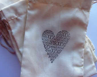 25  'Heart XOXO'  stamped muslin drawstring bags