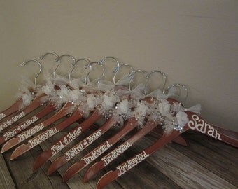 cherry wood stained hand painted hangers for bridesmaids, flower girls, brides, grooms, groomsmen, and mothers