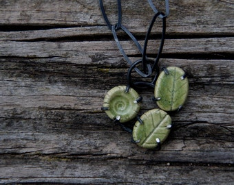 Flora and fauna - ceramic assemblage necklace on sterling silver