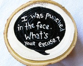 """Quote: """"I was punched in the face, what's your excuse"""" -Max Fischer, Rushmore - Wes Anderson  - wooden words font speech bubble"""