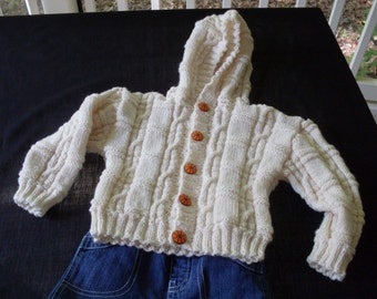 Hand knit baby boy or girl cream colored hoodie cardigan