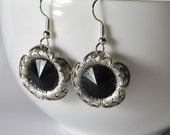 Delicate antiqued silver flower petal earrings with black middles