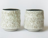 Two white and buff teacups with Australian Flannel Flower design