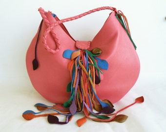 Salmon leather shoulder handbag with purple. pink, blue and orange leaf fringe by Tuscada. Ready to shop.